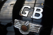 Chrome GB badge denoting Great Britain on a vintage car on show at a monthly meet up in Greenwich Market in London, England, United Kingdom.