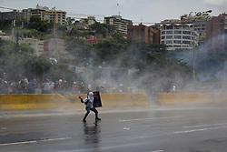 May 31, 2017 - Caracas, Capital District, Venezuela - Group of opposition protesters were repressed. The Bolivarian National Guard prevented the march of the opposition from reaching the Ministry of Foreign Affairs in the center of Caracas with tear gas and water jets this May 31, 2017 in Caracas, Venezuela. (Credit Image: © Adrian Manzol via ZUMA Wire)