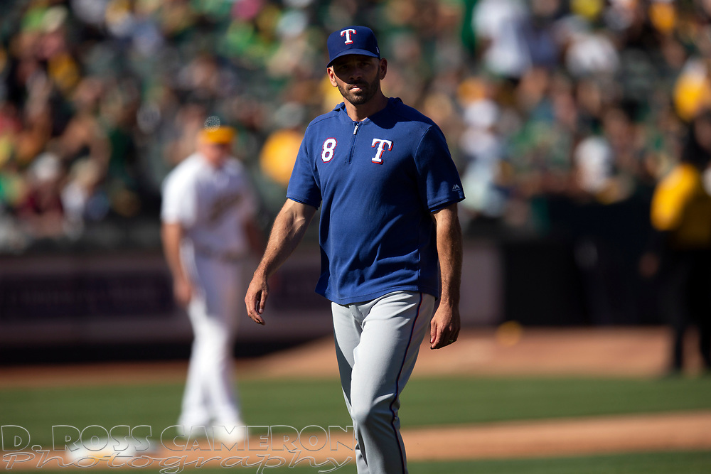 Texas Rangers manager Chris Woodward walks back to the dugout after making a pitching change during the sixth inning of a baseball game against the Oakland Athletics, Sunday, Sept. 22, 2019, in Oakland, Calif. (AP Photo/D. Ross Cameron)