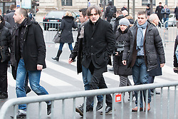 "FILE IMAGE © Licensed to London News Pictures. 10/01/2016. France, Paris. Charlie Hebdo Editor Laurent Sourisseau ""Riss"" leaves after the anniversary ceremony on Place de le Republique surrounded by his 24/7 police protection. Today January 10th 2016. Photo credit: Hugo Michiels/LNP"