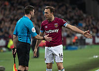 Football - 2018 / 2019 Premier League - West Ham United vs. Newcastle United<br /> <br /> Mark Noble (West Ham United) confronts the Assistant referee over a decision at the London Stadium<br /> <br /> COLORSPORT/DANIEL BEARHAM