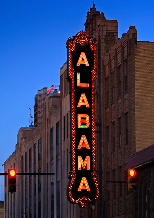 The marquee of the historic Alabama Theater stands high above the streets of Birmingham, Alabama.  Built in 1927, the theater is called the 'Show Place of the South', and is on the National Register of Historic Places.