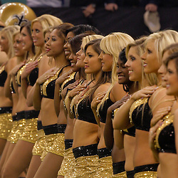 2009 October 18: New Orleans Saints Saintsations cheerleaders line up for the national anthem prior to kickoff of a 48-27 win by the New Orleans Saints over the New York Giants at the Louisiana Superdome in New Orleans, Louisiana.