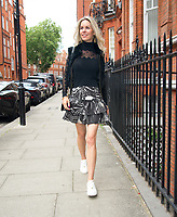 Leila Russack (Miss Zagato) out and about in London wearing Alexander McQueen sheer blouse and ruffle skirt