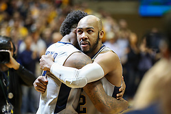 Feb 26, 2018; Morgantown, WV, USA; West Virginia Mountaineers guard Jevon Carter (2) hugs West Virginia Mountaineers guard Daxter Miles Jr. (4) during senior night ceremonies before their game against the Texas Tech Red Raiders at WVU Coliseum. Mandatory Credit: Ben Queen-USA TODAY Sports