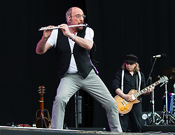© Licensed to London News Pictures. 14/06/2015. Newport, UK.   Ian Anderson performing live at Isle of Wight Festival 2015, Day 4 Sunday. an Scott Anderson, MBE is a British singer-songwriter and multi-instrumentalist, best known for his work as the lead vocalist, flautist and acoustic guitarist of British rock band Jethro Tull.  Headline acts include The Prodigy, Blur and Fleetwood Mac.   Photo credit : Richard Isaac/LNP