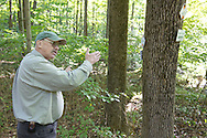 Warwick, New York - Interpretive guide and naturalist Gary Keeton talks to hikers at Fuller Mountain Preserve as part of the 2012 Hudson River Valley Ramble on Sept. 15, 2012. The preserve is owned and managed by the Orange County Land Trust.