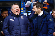 Wimbledon Manager Wally Downes and Shrewsbury Town Manager Sam Ricketts   during the EFL Sky Bet League 1 match between Shrewsbury Town and AFC Wimbledon at Greenhous Meadow, Shrewsbury, England on 2 March 2019.