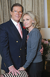 File Photo - Actor Roger Moore poses with his wife Kristina Tholstrup in Paris, France on October 30, 2008. Actor Sir Roger Moore, best known for playing James Bond, has died aged 89, his family has announced. He played the famous spy in seven Bond films including Live and Let Die and the Spy Who Loved Me. Photo by Pascal Baril/Planete Bleue Images/ABACAPRESS.COM