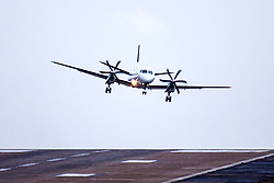 © Licensed to London News Pictures. 08/02/2019. Leeds UK. An Flybe aircraft struggles to land in strong cross winds at Englands highest airport, Leeds Bradford International, as Storm Erik begins to batter the UK. Photo credit: Andrew McCaren/LNP