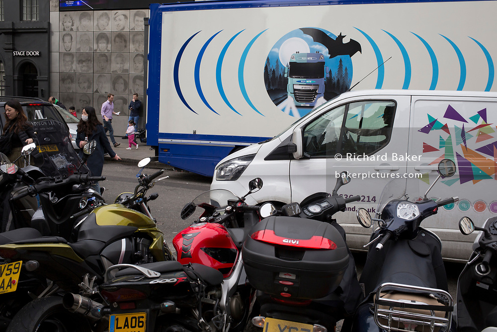 The design on the side of an HGV for the rehearsal studio company 'Fly By Nite' and and a courier van in Great Marlborough Street, on 5th March 2019, in London, England.