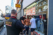 "A man is being arrested by the plainclothes police in the Middlesex Street, nearby Liverpool Street station in London on Thursday, Aug 20, 2020. Police said they wanted to stop and search him and accused him of not cooperating. The man who said his name was Nicholas said ""of course I was running away from you. You didn't say who you're. I was afraid why were you running after me."" (VXP Photo/ Vudi Xhymshiti)"