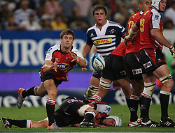 Rory Kockott feeds the backline during the Super Rugby (Super 15) fixture between the DHL Stormers and the Lions held at DHL Newlands Stadium in Cape Town, South Africa on 26 February 2011. Photo by Jacques Rossouw/SPORTZPICS