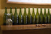 Bottles lined up in the tasting room marked with chalk writing and two upside-down wine glasses and corks, Maison Louis Jadot, Beaune Côte Cote d Or Bourgogne Burgundy Burgundian France French Europe European