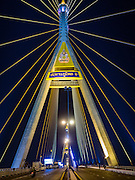 05 DECEMBER 2016 - BANGKOK, THAILAND: Bhumibol Bridge, normally crowed with cars and buses, was closed for a ceremony to honor the late King of Thailand. Tens of thousands of Thais gathered on Bhumibol Bridge in Bangkok Monday to mourn the death of Bhumibol Adulyadej, the Late King of Thailand. The King died on Oct 13 after a lengthy hospitalization. December 5 is his birthday and a national holiday in Thailand. The bridge is named after the late King, who authorized its construction. 999 Buddhist monks participated in a special merit making ceremony on the bridge.       PHOTO BY JACK KURTZ