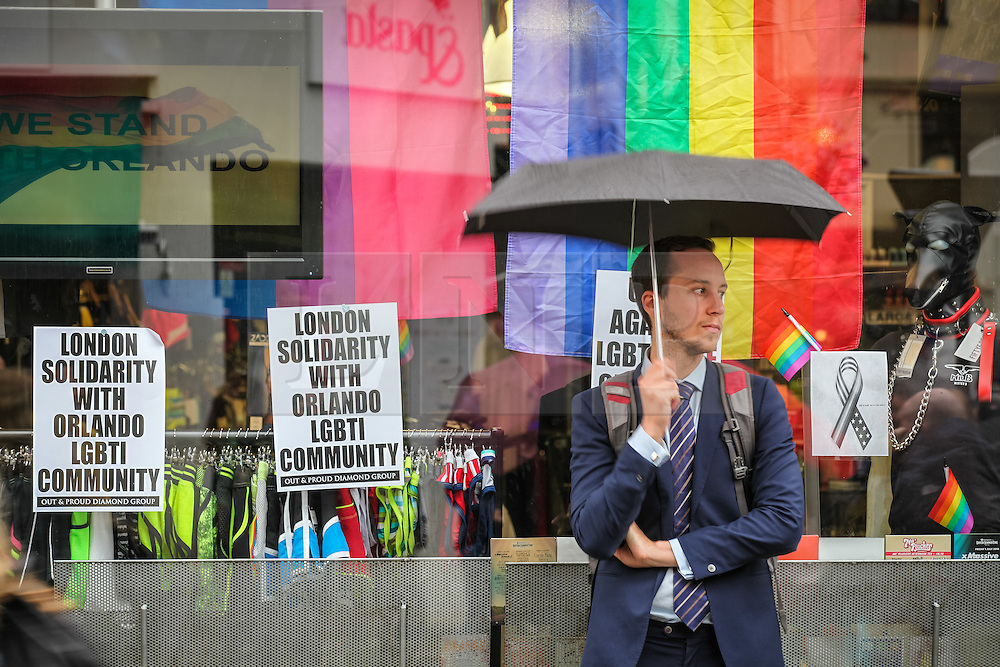 © Licensed to London News Pictures. 13/06/2016. London, UK. A man waits on Old Compton Street in Soho ahead of a vigil to pay tribute to the victims of the Pulse nightclub massacre in Orlando, Florida. In the early hours of 12 June 2016, 29-year-old Omar Mateen entered Pulse, a gay nightclub, and killed more than 50 people with an assault rifle, making it the deadliest mass shooting in US history. Photo credit: Rob Pinney/LNP