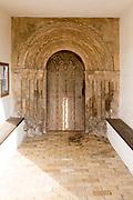 Norman stone arch door entrance in porch doorway village parish church, Saint Mary, Henstead, Suffolk, England, UK