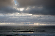 Images from the Lofoten Islands in arctic Norway at midsummer. Rays of light over the sea seen from Kvalvika Beach.