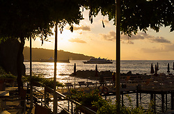 Sorrento, Italy, September 20 2017. Late afternoon sunshine at the beach of the Grand Hotel Ambasciatori sparkles on the waters of the bay of Naples in Sorrento, Italy. © Paul Davey