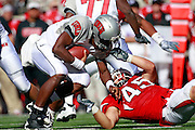 UNLV quarterback Omar Clayton (2) is face masked by Utah linebacker Boo Anderson (45) in the 4th quarter of an NCAA college football game at Rice-Eccles Stadium, Saturday, Sept. 11, 2010, in Salt Lake City, Utah. Utah defeated UNLV 38-10.  (AP Photo/Colin E. Braley)