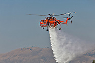 Erickson Air-Crane helitanke on a demonstration air-drop run..Media day for LA county's firefighting aircraft at Van Nuys Airport. .2 Cl-425 Supercoopers on lease from Quebec. 1 Sikorsky S-70 Firehawk, and 1 Erickson Air-Crane helitanker were on display. .Fire season is expected to begin soon in LA with the arrival of the Santa Ana winds later this week.