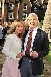 LORD BRIAN DAVIDSON and his wife ROSIE at The Lady Taverners 25th Anniversary Westminster Abbey Garden Party held in The College Gardens, Westminster Abbey, London o 11th July 2012.