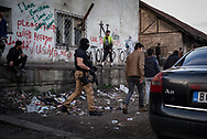 Serbian police storming the camp searching for smugglers. The price to try to cross is about 1500 euros and the migrants unable to pay often get were as hostages in the warehouse. Belgrade, Serbia. March 20th, 2017. Federico Scoppa
