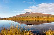 Reflection of Gunsight Mountain in Knob Lake in the Matanuska Valley of Southcentral Alaska. Autumn. Morning.