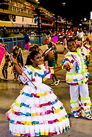 Flag bearer (porta bandeira) and mestre-sala  (boy) in the Children's Carnaval parade in the Sambadrome, Rio de Janeiro, Brazil.Sambadrome, Rio de Janeiro, Brazil.