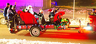 North Merrick, New York, USA.  December 19, 2020. North Merrick Fire Department has its annual Santa Claus ride in red sleigh pulled by NMFD fire truck that goes through the streets of North Merrick community.