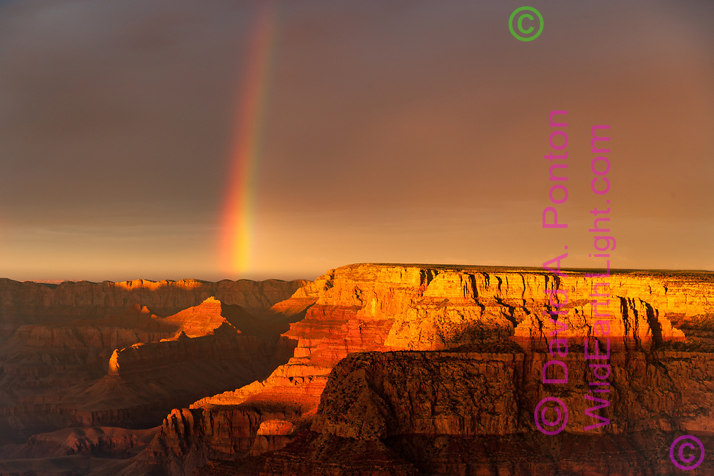 Rainbow and the last sunlight of the day on the southeast rim of the Grand Canyon. © David A. Ponton