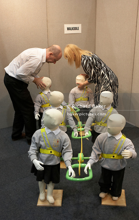 The Walkodile for better child safety is demonstrated by an entrepreneur at an inventors fair in Alexandra Palace, London