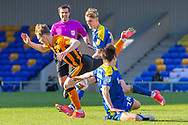 Free-kick AFC Wimbledon midfielder George Dobson (24) fouls Hull City forward Keane Lewis-Potter (19) during the EFL Sky Bet League 1 match between AFC Wimbledon and Hull City at Plough Lane, London, United Kingdom on 27 February 2021.