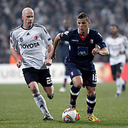 Besiktas's Fabian Ernst (L) and Braga's Lima (R) during their UEFA Europa League Round of 32 matchday 8 soccer match Besiktas between Braga at Inonu stadium in Istanbul Turkey on Thursday February 23, 2012. Photo by TURKPIX