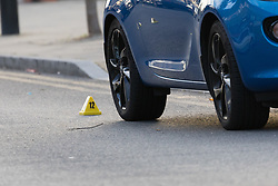 © Licensed to London News Pictures. 13/10/2018. London, UK.  A forensic markersseen in the road next to a car at the crime scene at Manford Way in Hainault, where police were called at approximately 10:20pm last night to reports of two men stabbed in Manford Way, Hainault and one man, believed aged 23, was pronounced dead at the scene. The second man, believed aged 22, was taken to an east London hospital for treatment where he remains in a critical condition..  Photo credit: Vickie Flores/LNP
