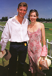 Top ballerina DARCEY BUSSELL and her husband MR ANGUS FORBES at a polo match in West Sussex on 18th July 1999.MUH 26