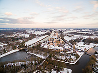 Aerial view of snow cityscape during scenic sunset, Lochem, Netherlands.