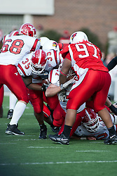 28 October 2006: Demetrius Ison squeezes between his blockers. Youngstown State turned off over 15,000 fans as the win blew their way, cooling off Illinois State 27-13. Nationally ranked teams Youngstown State Penguins and Illinois State Redbirds competed at Hancock Stadium on the campus of Illinois State University in Normal Illinois.<br />