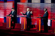 Rick Perry, Ron Paul, and Herman Cain..Eight republican candidates for US President face off at a debate held at the Ronald Reagan Library. The debate was sponsored by NBC News and POLITICO, and was moderated by Brian Williams, anchor of NBC Nightly News.