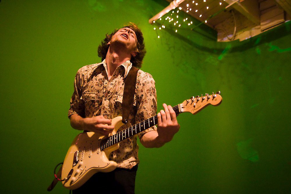 Guitarist and singer Tom Beecham, frontman of The Raggedy Anns, performs with rock band Song Sparrow Research at an underground music venue in Seattle, Washington.