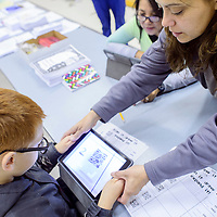 Heather Dryden, right, helps Eli Garcia scan a math puzzle with an iPad during the Science Technology Engineering Arts and Mathematics Forum at Stagecoach Elementary School in Gallup Saturday.