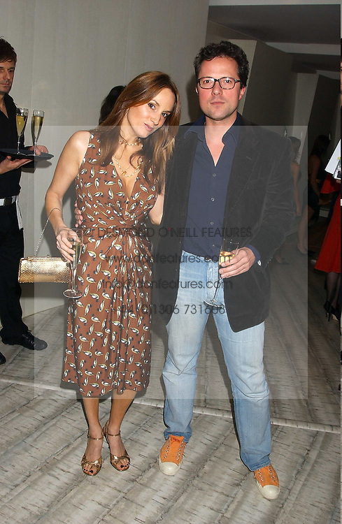 EMILY OPPENHEIMER-TURNER and her husband WILLIAM TURNER at a dinner hosted by Arnaud Bamber MD of Cartier, Amanda Sharp and Matthew Slotover Directors of the Frieze Art Fair to celebrate artists featured in the 2005 Frieze Art Fair Curatorial Programme at Nobu-Berkeley, 15th Berkeley Street, London on 21st October 2005.<br /><br />NON EXCLUSIVE - WORLD RIGHTS