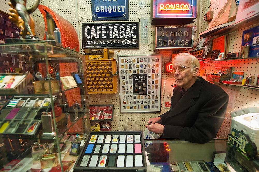 LONDON, ENGLAND - JANUARY 16:  One of the stall holders at the Admiral Vernon Arcade in Portobello Road on January 16, 2010 in London, England. Portobello traders fear for the Market's future after Lipka's Antiques Arcade, where more than 150 traders had their stalls, was redeveloped to accommodate a large High street chain store.  (Photo by Marco Secchi/Getty Images)