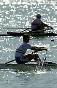 Photo  Peter Spurrier.30/08/2003 Saturday.2003 World Rowing Championships, Idroscala. Milan, Italy.  {A Finals].Britains, Tom Kay [foreground] sculling the final stage of the men's lightweight single sculls and winning silver...... Milan. ITALY 2003 World Rowing Championships. Idro Scala Rowing Course. [Mandatory Credit: Peter Spurrier: Intersport Images.]