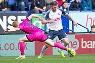 Bolton Wanderers forward Daryl Murphy tackled by Paul McShane of Rochdale during the EFL Sky Bet L eague 1 match between Bolton Wanderers and Rochdale at the University of  Bolton Stadium, Bolton, England on 19 October 2019.
