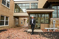 "Reverend Dr. Warren Bouton stands outside the new entryway with the ""bridge"" connecting the Congregational Church with the office complex on the upper level.    (Karen Bobotas/for the Laconia Daily Sun)"