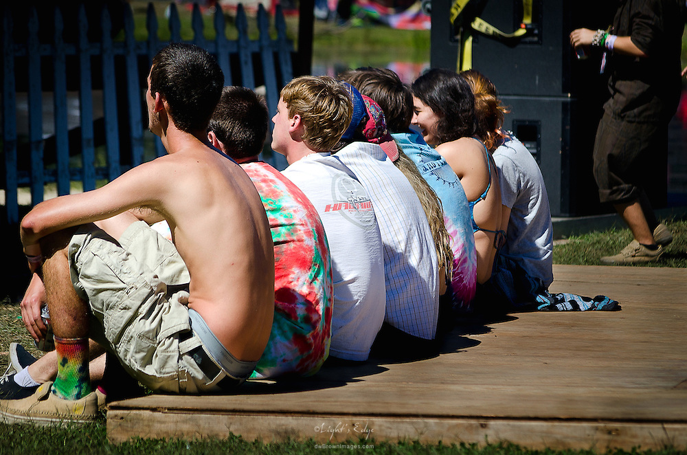 A group of young festival goers get a front row view of the opening bands at the 2012 late summer Camp Jam In The Pines.
