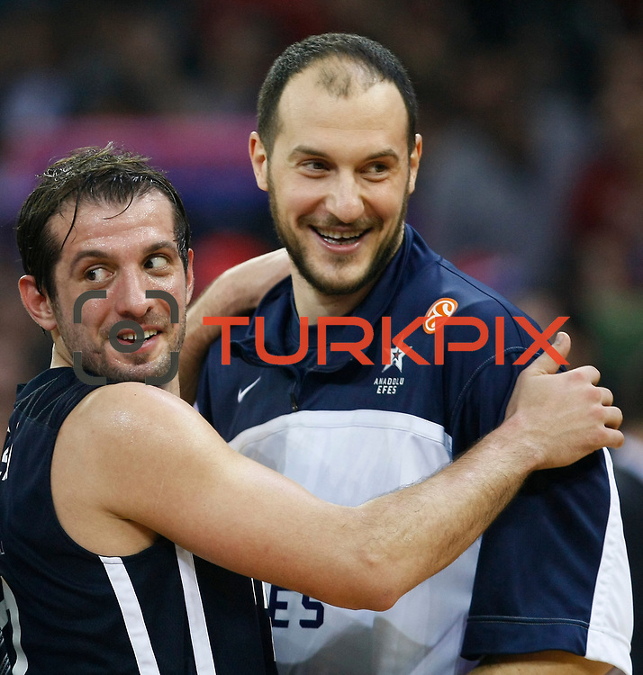 Anadolu Efes's Kerem Tunceri (L) and Ermal Kurtoglu (R) celebrate victory during their Euroleague Top 16 game 8 basketball match Anadolu Efes between CSKA Moscow at the Abdi Ipekci Arena in Istanbul at Turkey on Friday, February, 22, 2013. Photo by TURKPIX