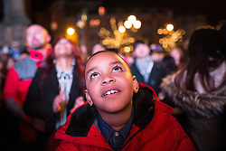 © Licensed to London News Pictures . 01/01/2016 . Manchester , UK . Thousands of people turn out in freezing temperatures to watch as Manchester celebrates the start of the New Year with a fireworks display in front of the Town Hall in Albert Square . Photo credit : Joel Goodman/LNP