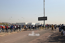 South Africa - Durban - 03 August 2020 - Police disperse angry protesting truck drivers cause havoc on the N2 Freeway near Isipingo, South of Durban when they went on a rampage, stoning trucks passing by in a move steered by their anger over being overlooked by employers hiring foreigners over them, even though they have the required skills<br /> Picture: Doctor Ngcobo/African News Agency(ANA)